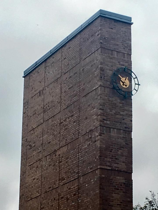 The clock tower includes two chimneys for functional wood burning fireplaces which are still in use. The clock is off-center because Eliel Saarinen likened it to a pocket watch.