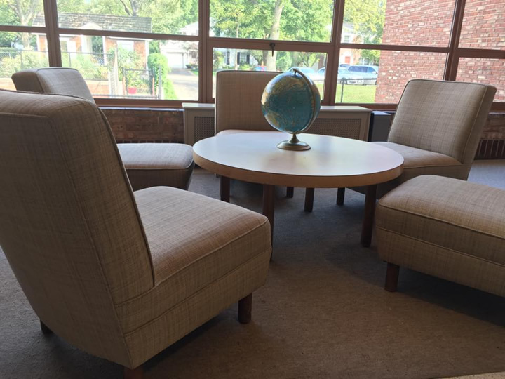 The original furniture designed by Eero Saarinen still sits in the lobby in front of the auditorium